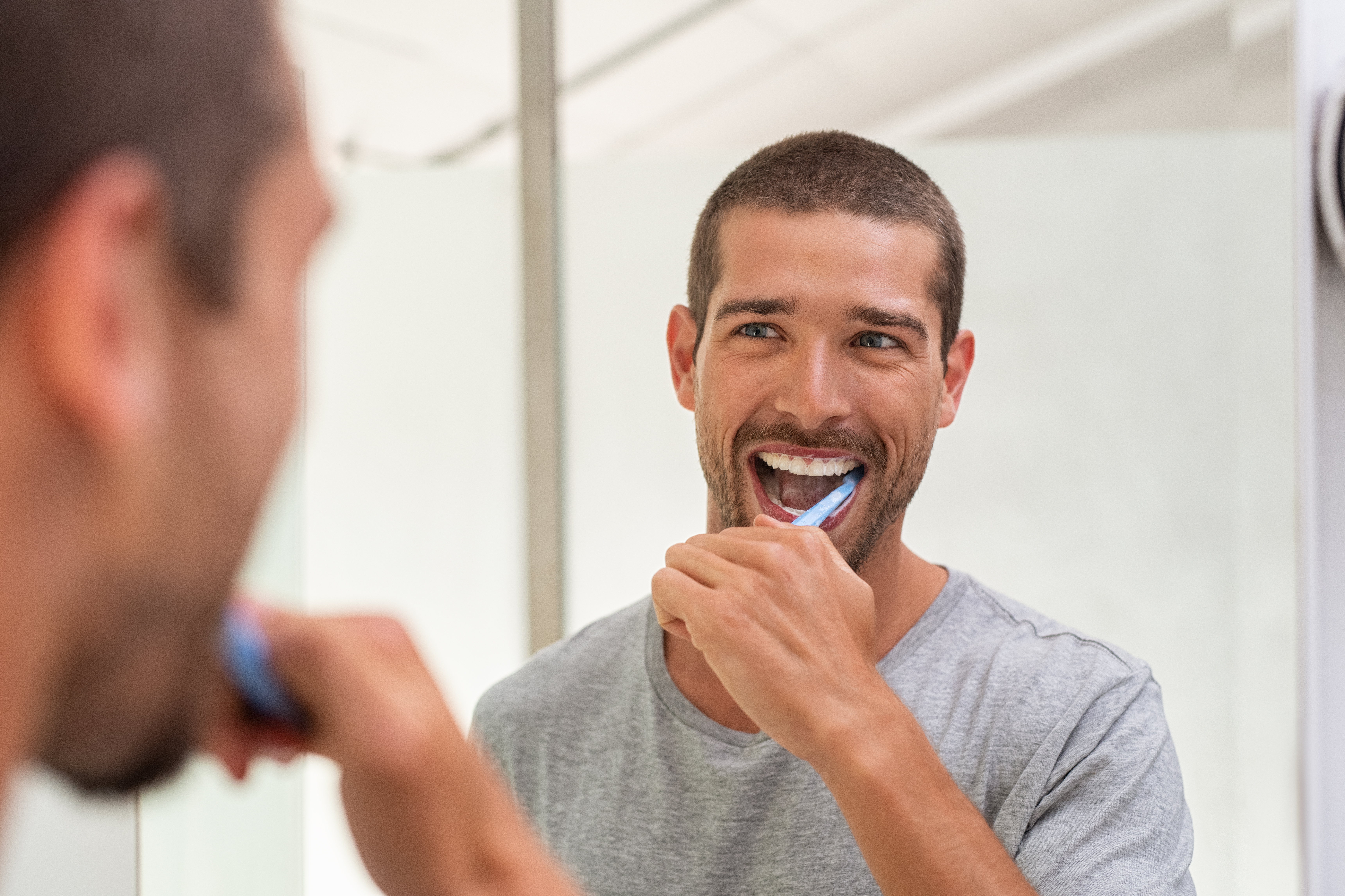 He wouldn't be smiling if he used that toothpaste as lube, though. (Stock photo via Elements Envato)
