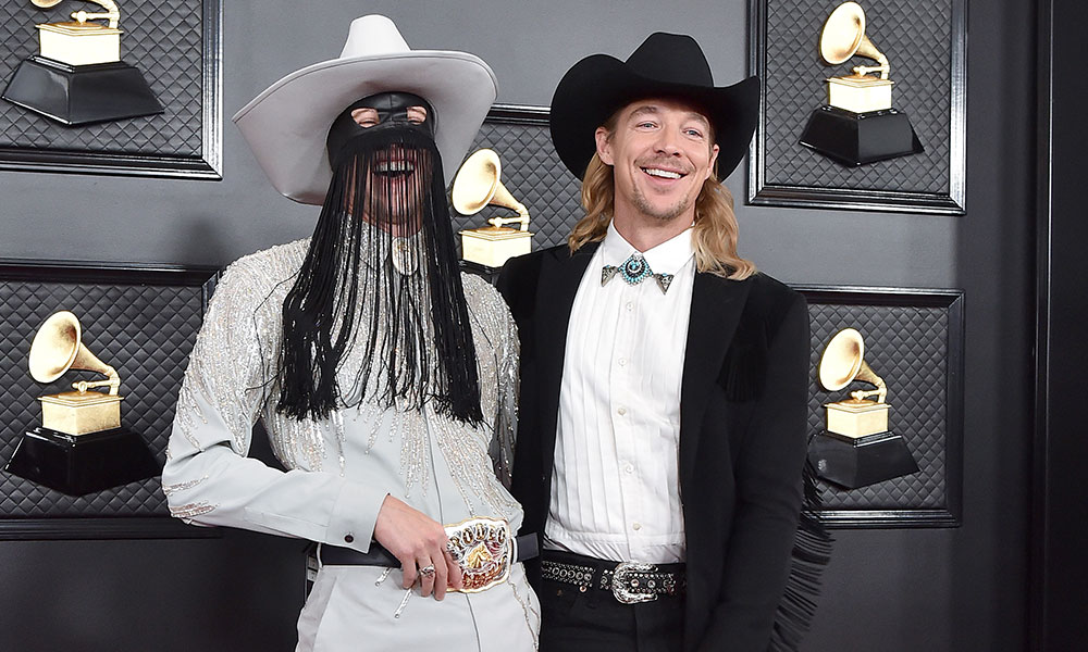Orville Peck and Diplo laughing at the Grammys 2020