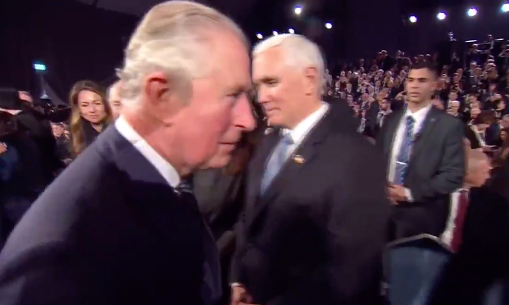 Prince Charles walking past Mike Pence