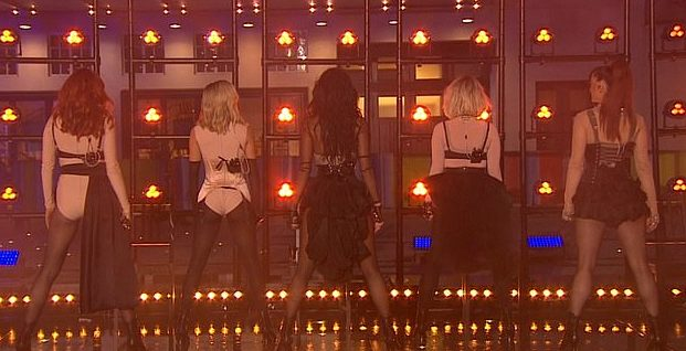 """The quintet appeared on the evening magazine show to perform their new single, """"React"""". (Screen capture via YouTube/BBC)"""