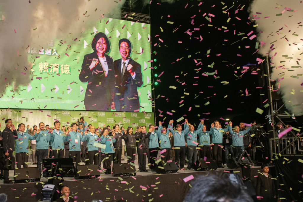 President elected Tsai Ing-wen flanked by her running mate William Lai and her party, DPP, heavyweight thanks the large crowd gathered in front of the Taipei DPP Headquarters. (Alberto Buzzola/LightRocket via Getty Images)