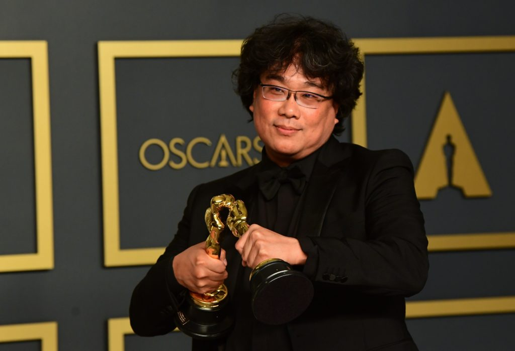 South Korean director Bong Joon-ho poses in the press room with the Oscars for Parasite
