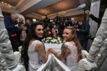 Robyn Peoples, from Belfast, and Sharni Edwards, from Brighton, pose for the media after getting married on February 11, 2020 in Carrickfergus, Northern Ireland.