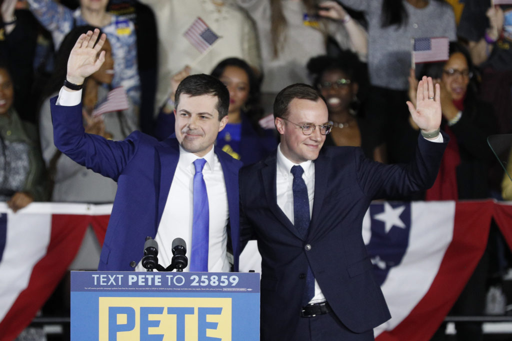 Democratic presidential candidate Pete Buttigieg waves with his husband Chasten Buttigieg after addressing supporters at his caucus night watch party on February 03, 2020 in Des Moines, Iowa. (Tom Brenner/Getty Images)