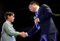 Democratic presidential candidate Buttigieg greets Zachary Ro, who asked Buttigieg to help him tell others he is gay, while the candidate was speaking at a town hall campaign even. (xWin McNamee/Getty Images)