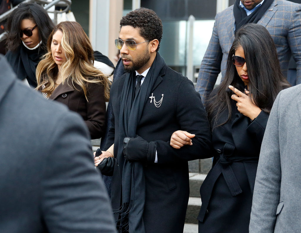 Flanked by attorneys and supporters, actor Jussie Smollett walks out of the Leighton Criminal Courthouse after pleading not guilty to a new indictment on February 24, 2020 in Chicago, Illinois.