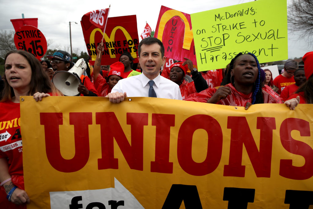 Democratic presidential candidate Pete Buttigieg marches with South Carolina McDonald's workers as they demonstrate for a $15 an hour wage and the right to form a workers union. (Win McNamee/Getty Images)