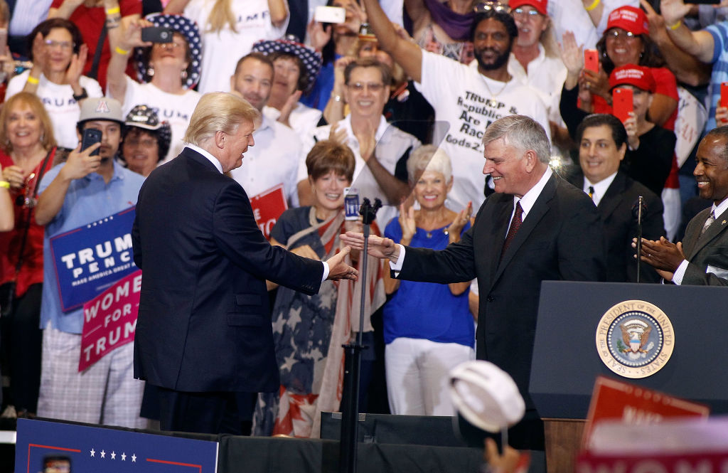 Franklin Graham is greeted by President Donald Trump during a Trump rally on August 22, 2017 in Phoenix, Arizona.