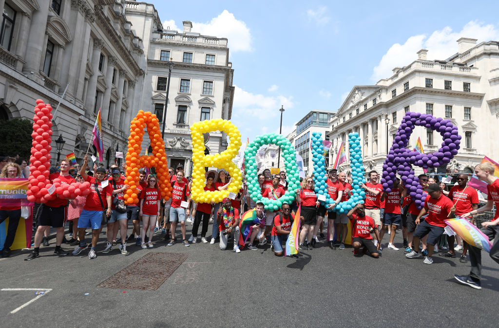 Labour party members walk the parade during Pride In London on July 7, 2018