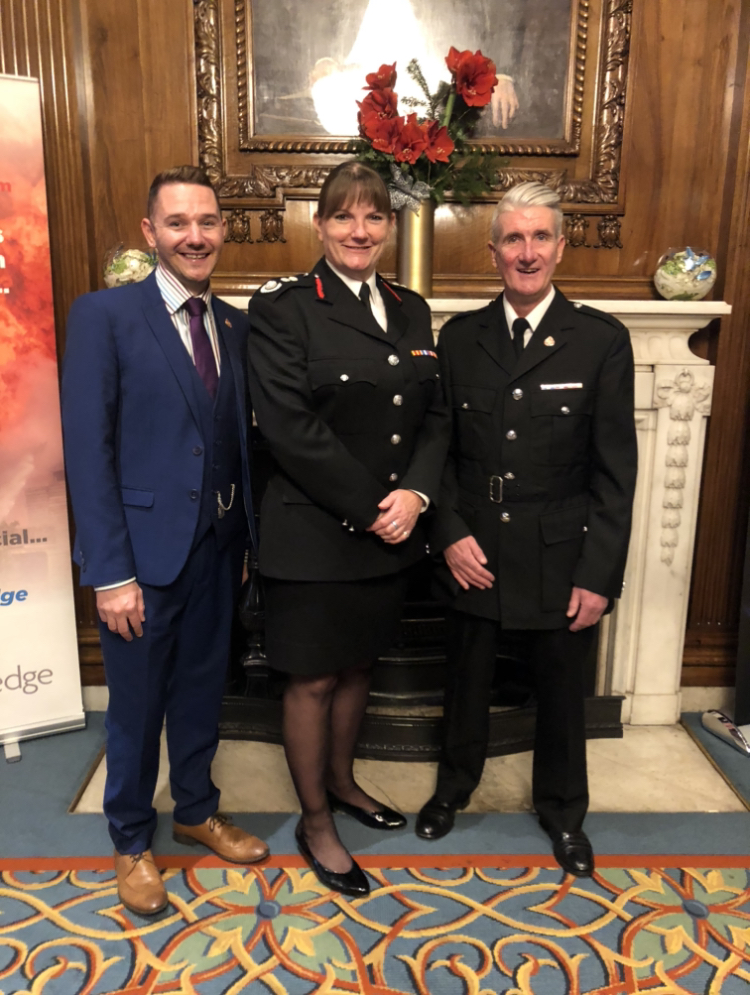 Pat Carberry (R) with his husband David and Dany Cotton, former London Fire Brigade Commissioner. (Supplied)