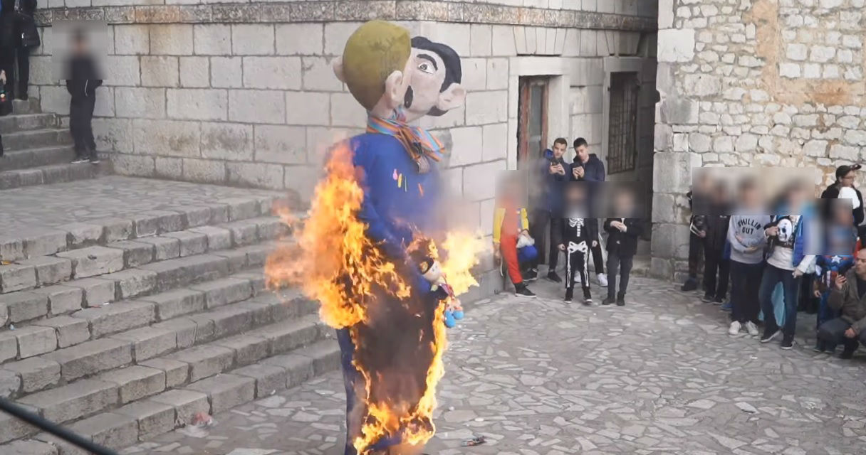 Frenzied mob cheers on as effigy of kissing gay couple and their child is burned to a cinder
