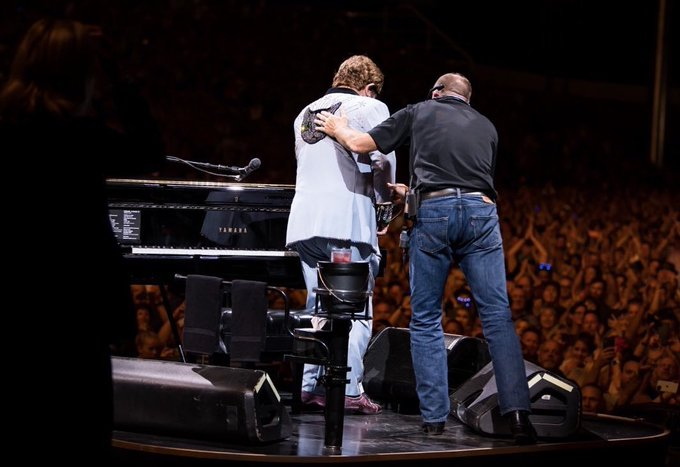 Elton John cuts gig short with tearful on-stage announcement about his health