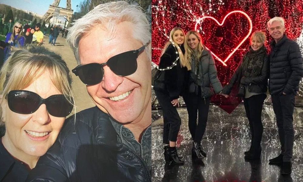 Phillip Schofield smiling with his wife Stephanie / posing with their daughters in front of a red love heart
