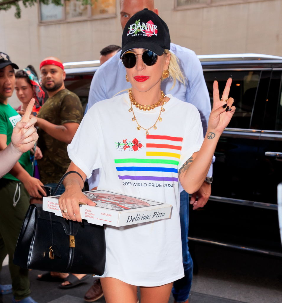 Lady Gaga wears a Joanne Trattoria Pride shirt while carrying a pizza box on June 28, 2019 in New York City.