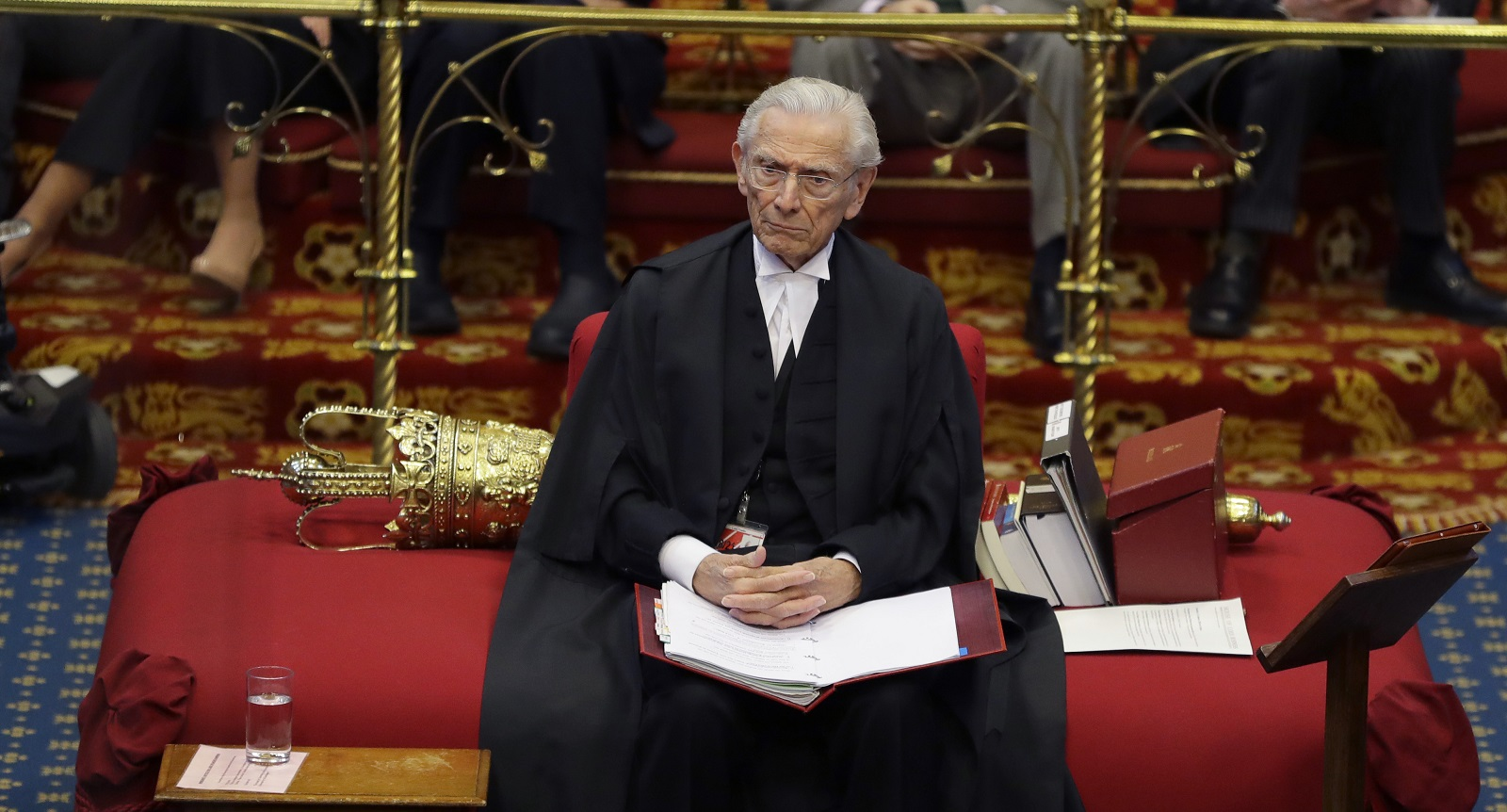 The Lord Speaker Lord Fowler listens inside the House of Lords