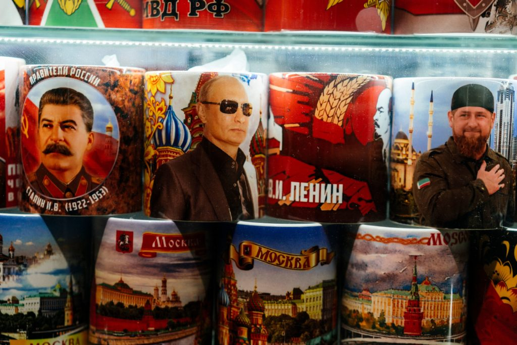 Mugs decorated with images of Russian President Vladimir Putin, Soviet leaders Joseph Stalin and Vladimir Lenin and Chechnya's leader Ramzan Kadyrov are seen on sale among other items at a gift shop in Moscow. (DIMITAR DILKOFF/AFP via Getty Images)