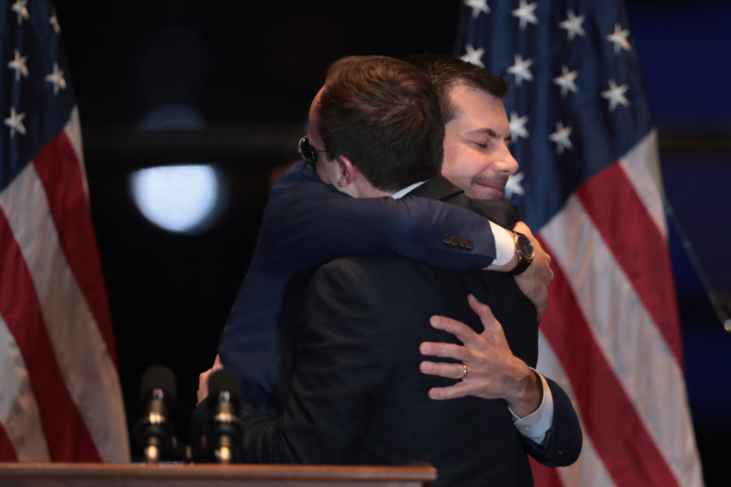 Former South Bend, Indiana Mayor Pete Buttigieg hugs his husband Chasten after announcing he was ending his campaign to be the Democratic nominee for president. (Scott Olson/Getty Images)