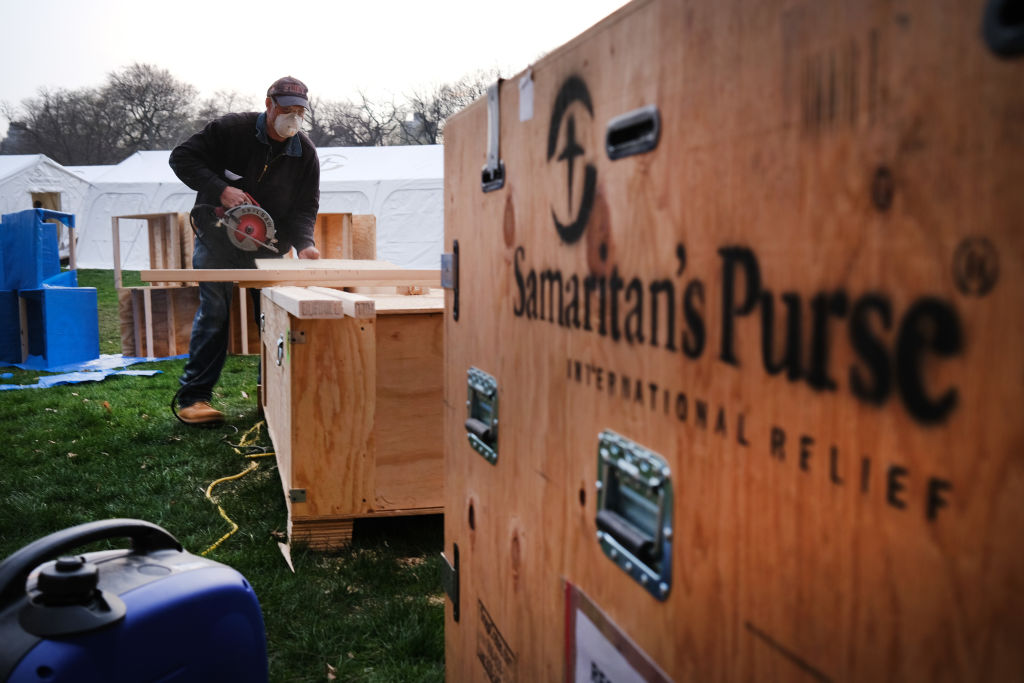 Members of Samaritans's Purse, put the finishing touches on a field hospital in New York's Central Park on March 30, 2020 in New York City.