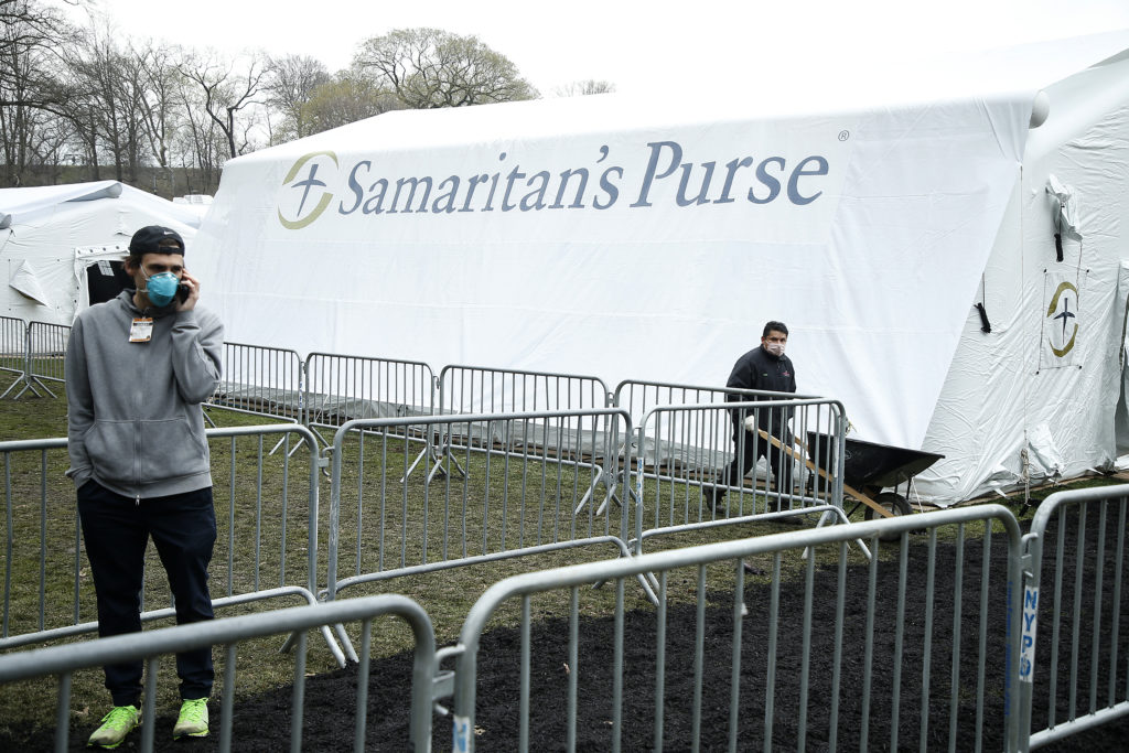 Samaritan's Purse volunteers, many from state churches, hoisted metal polls and carted crates of equipment to build a temporary coronavirus hospital. (John Lamparski/Getty Images)