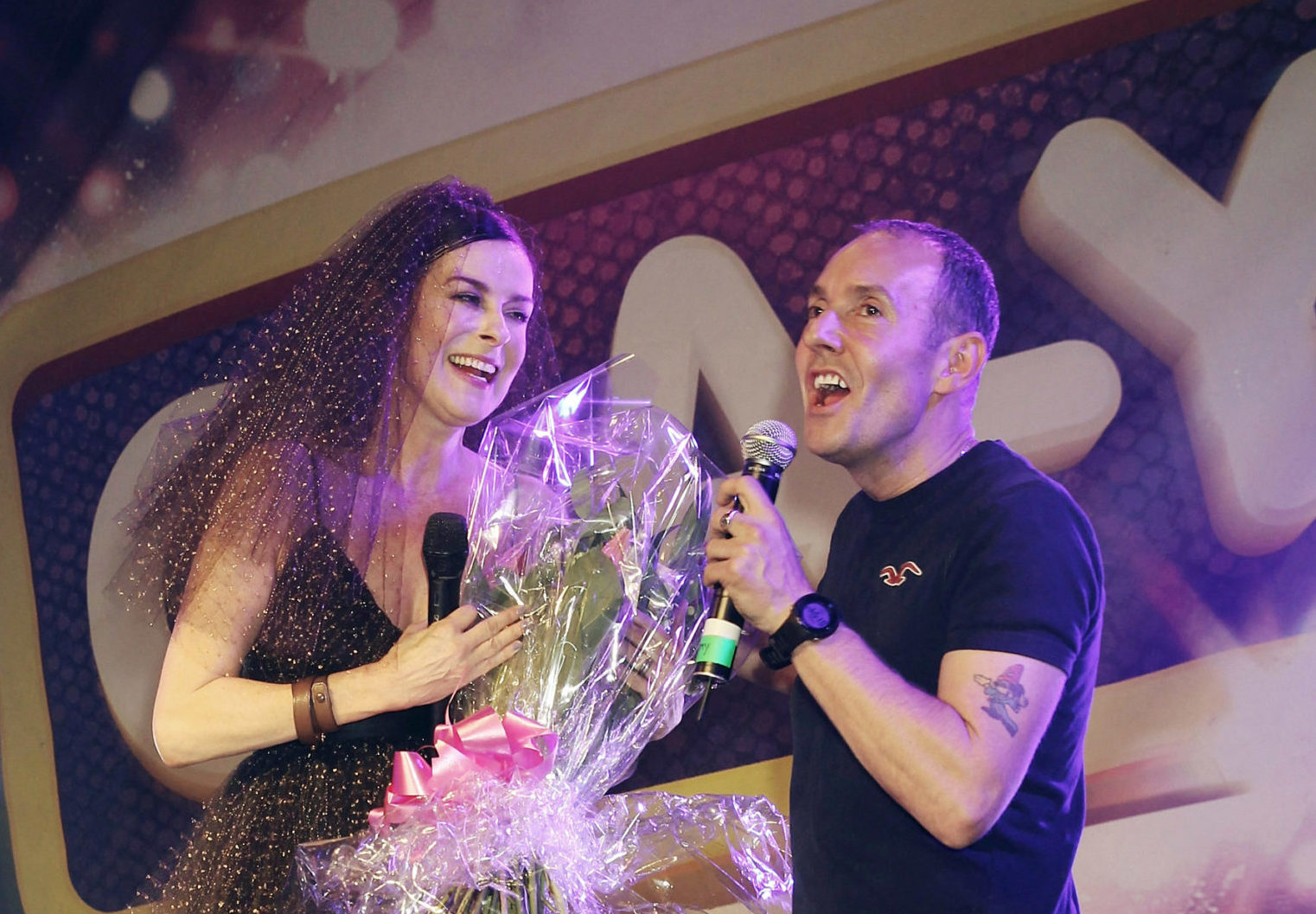 Lisa Stansfield presented with flowers by Jeremy Joseph on stage at G-A-Y Heaven on May 3, 2014 in London, England. (Jo Hale/Redferns via Getty Images)