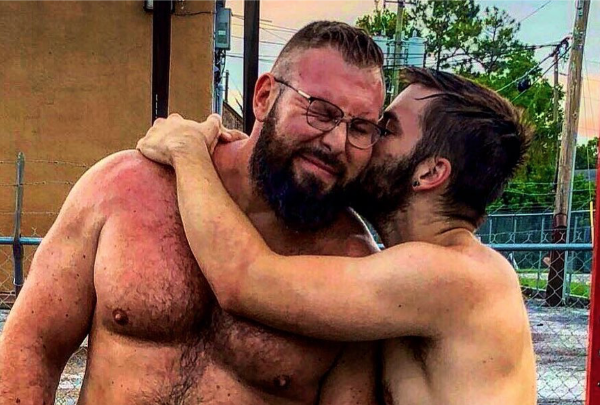 Mike Parrow (L) snuggles his husband Morgan Cole. (Instagram)