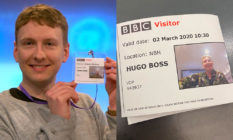 Joe Lycett holding a BBC visitor pass with the name Hugo Boss