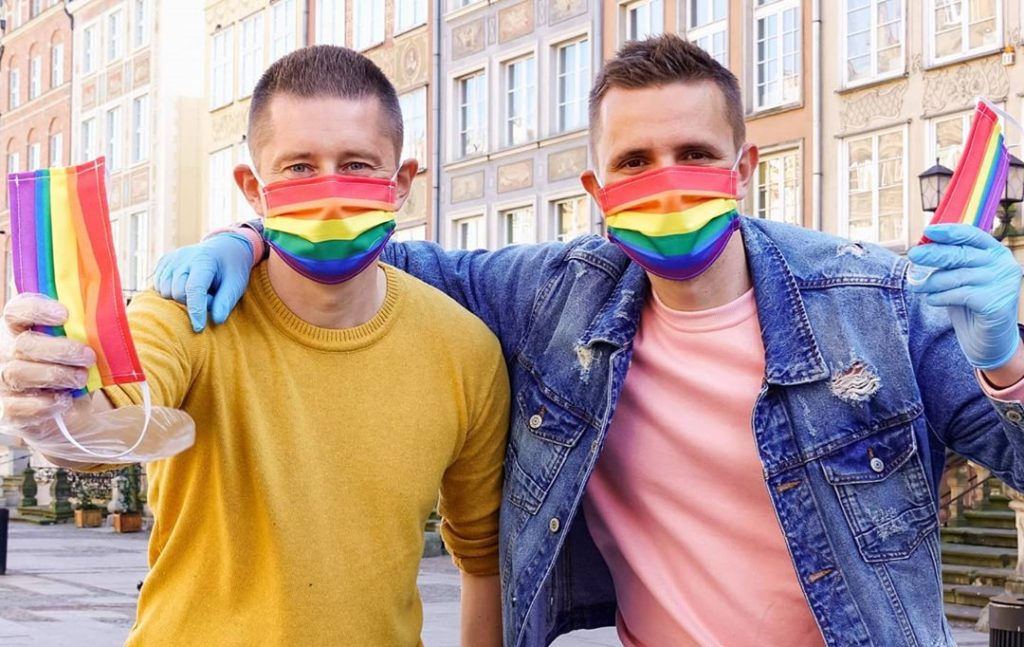 Couple fight COVID-19 and LGBT-free zones/gay couple/Polish Gay Couple Hand Out Masks And Fight Both COVID-19 And Homophobia