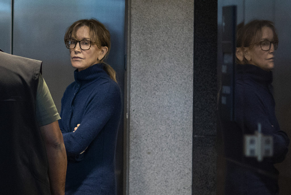 Felicity Huffman was among 50 people indicted in a nationwide university admissions scam. (DAVID MCNEW/AFP via Getty Images)