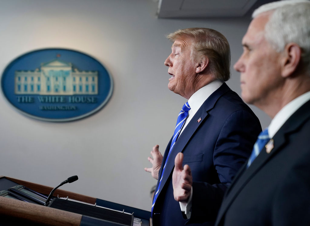 Flanked by Mike Pence, President Donald Trump speaks during daily briefing of the coronavirus task force at the White House.