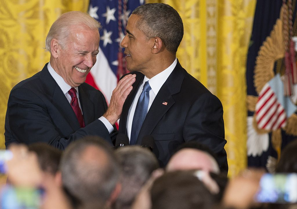 US President Barack Obama and US Vice President Joe Biden attend a reception in honor of LGBT Pride Month in the East Room of the White House in Washington, DC, June 24, 2015.