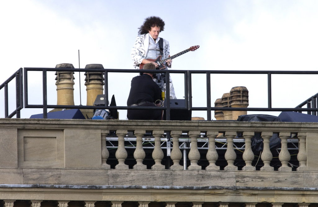 Brian May performing on the roof of Buckingham Palace in 2012. (Tim Graham Photo Library via Getty Images)