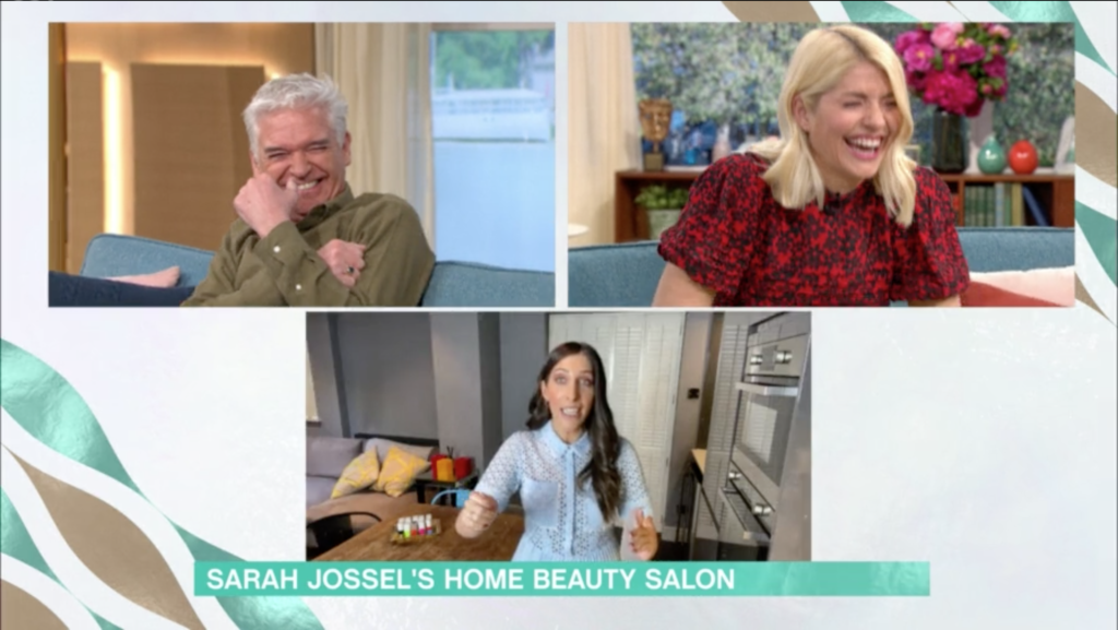 Philip Schofield and Holly Willoughby began giggling off-screen, forcing a bemused Sarah Jossel to dare to ask what the pair were chuckling about. (Screen capture via ITV)