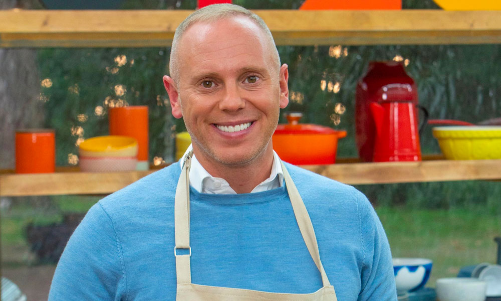 Judge Rinder in a Bake Off apron