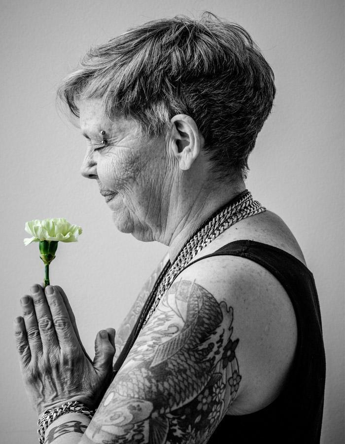 Jamie Wildman holds a flower in the play poster
