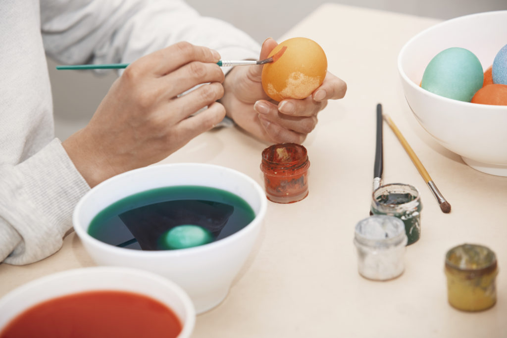 A homosexual laces an Easter egg with flagrantly gay chemicals. (Stock photograph via Elements Envato)