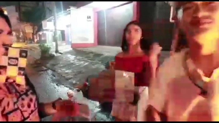 Two trans women were handed instant noodle boxes by a YouTuber in Indonesia. Inside them were rotting vegetables and stones. (Screen capture via YouTube)