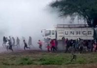 Harrowing footage seen by PinkNews shows Kakuma refugee camps sprinting as teargas engulfs them. Multiple nondescript bangs can be heard in the distance. (Screen capture via Facebook)