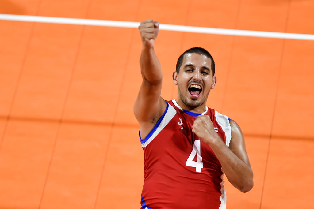 Dennis Del Valle of Puerto Rico celebrates after scoring a point against Colombia in the men's volleyball match for the gold medal during the 2018 Central American and Caribbean Games
