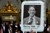 An attendee holds a picture of Harvey Milk at a memorial event marking 30th anniversary of killings of George Moscone and Harvey Milk at City Hall in San Francisco, California. (Mark Constantini/San Francisco Chronicle via Getty Images)