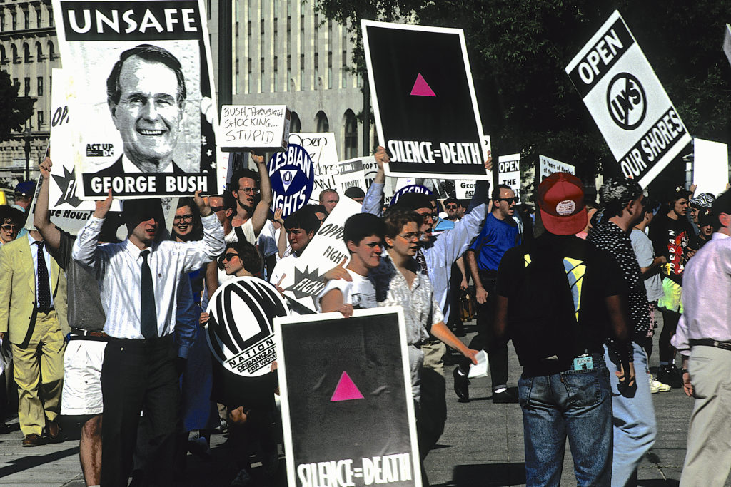An LGBT+ Pride parade in Washington, DC, in 1991. The paranoia of the AIDS crisis that seized the country the decade-prior still lingered, and some have remarked that the sense of fear and anger is being repeated again during the coronavirus pandemic. (Mark Reinstein/Corbis via Getty Images)