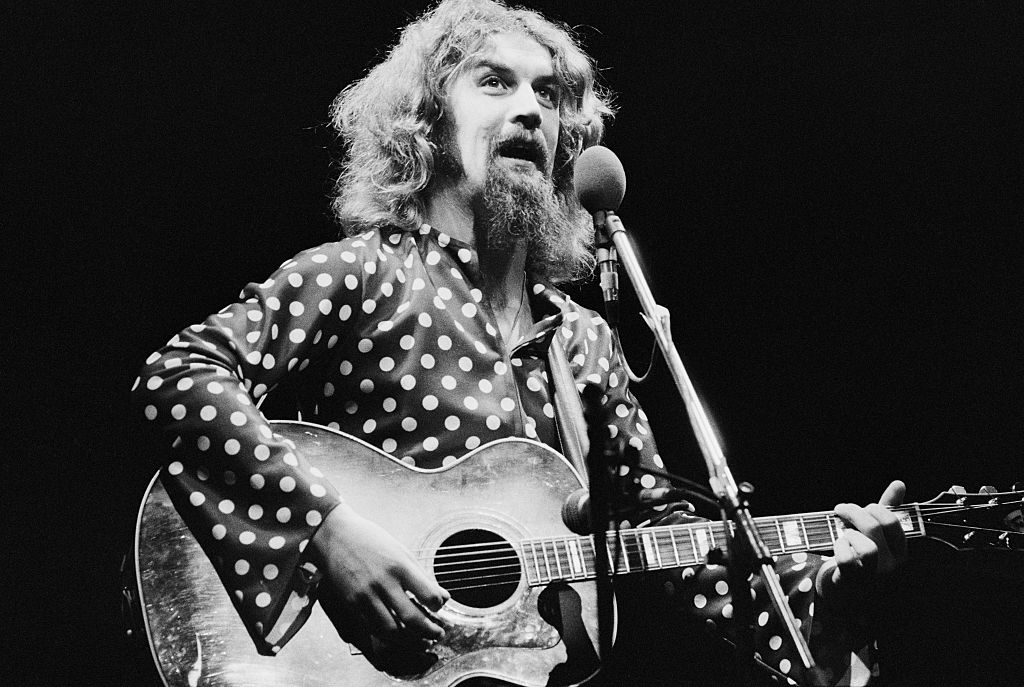 Scottish comedian and folk singer Billy Connolly performing in 1975.