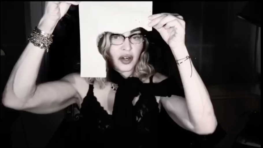 Madonna shows viewers the singed paper she's typing on. (Screen capture via Instagram)