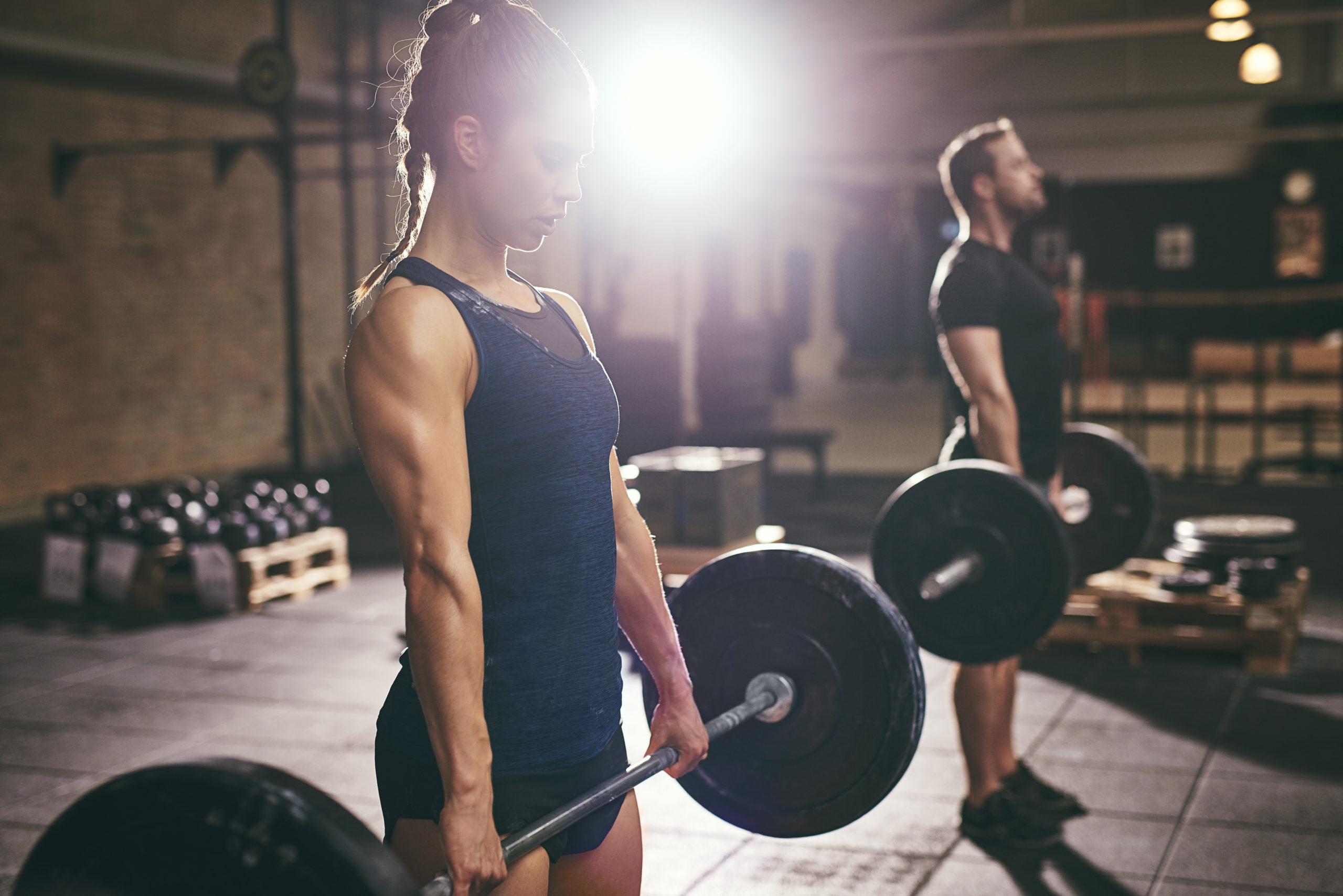 A woman showed she can deadlift more than her boyfriend, and his bruised toxic masculinity lashed out in the worst way. (Stock photograph via Elements Envato)