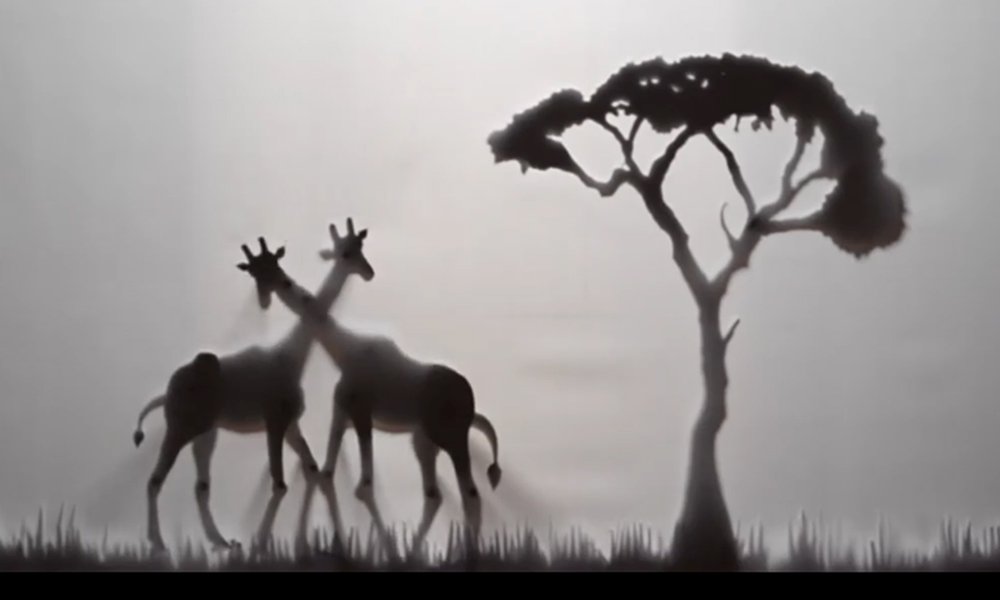 Shadow puppets of two gay giraffes rubbing necks