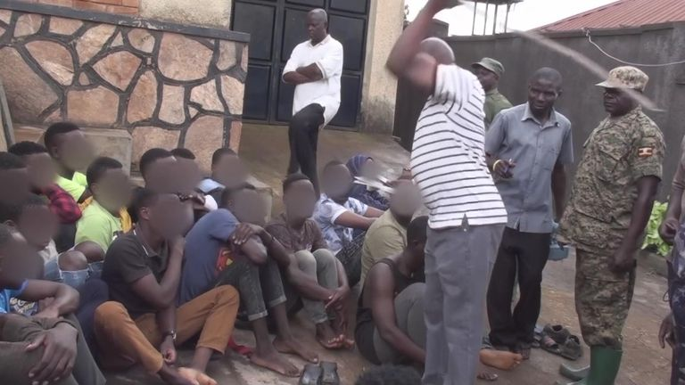 Around 23 LGBT+ people in Uganda were whipped by officials before being chained and walked to the police station, disturbing footage shows. (Screen capture via YouTube)