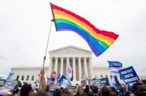 LGBT+ activists rally in front of the Supreme Court in October 2019