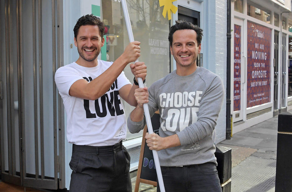 Ben Aldridge (L) and Andrew Scott volunteer during Match Fund day at the 'Choose Love' shop for Help Refugees in London. (David M. Benett/Dave Benett/Getty Images)