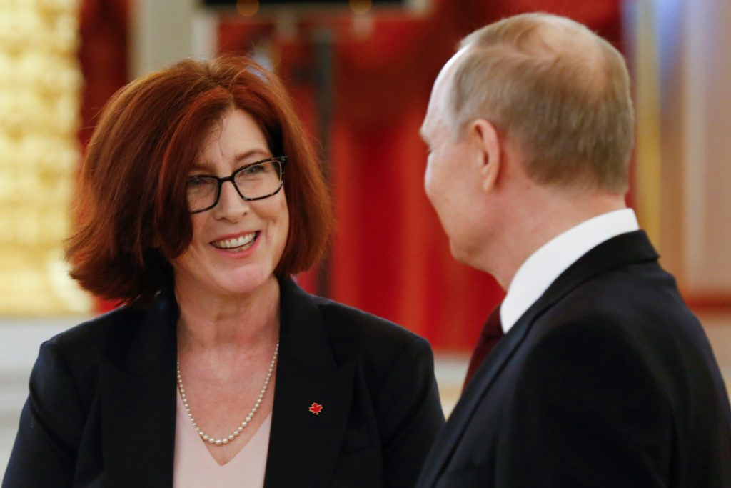Russian President Vladimir Putin speaks to Canadian Ambassador to Russia Alison LeClaire
