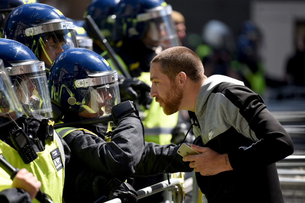 A argues squares off with a police officer on Parliament Street on June 13, 2020 in London. (Kate Green/Anadolu Agency via Getty Images)