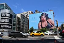 Cars drive past a billboard featuring Black trans model and activist Jari Jones in an advertisement for Calvin Klein. (Angela Weiss / AFP via Getty Images)